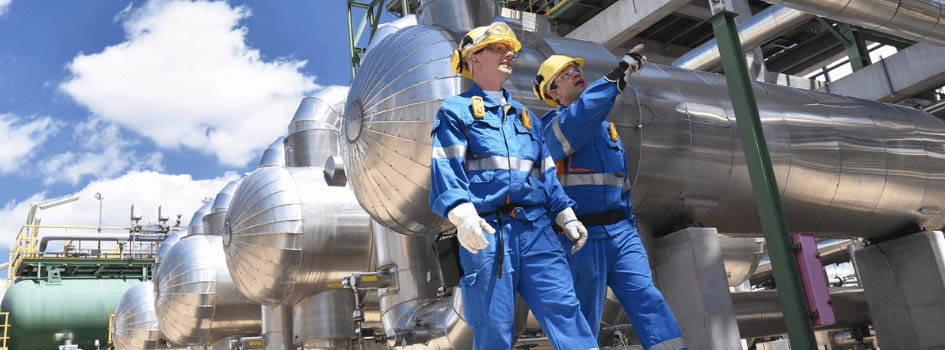 Engineers walking at oil fermentation plant